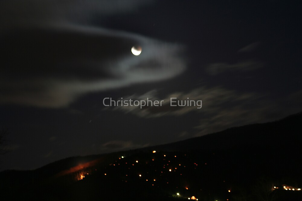 eclipse over the embers by Christopher  Ewing
