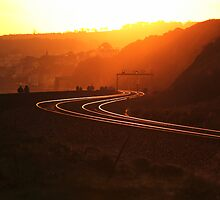 train tracks at sunset by james broadley