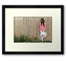 Lonely 12 year old with white hat Framed Print