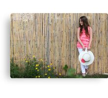 Lonely 12 year old with white hat Canvas Print