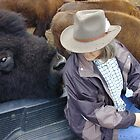 Rancher and her bull bison by Chris Clarke