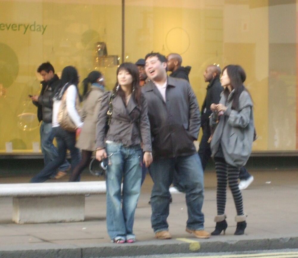 Laughing in Oxford Street by Deirdre Banda