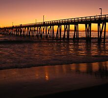 Sunset at the Pier by Mariann Kovats