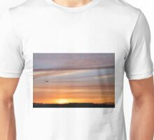 Bird flying home to roost in Autumn sunset Unisex T-Shirt