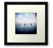 the guys out in sea Framed Print
