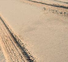 Tire tracks in the sand by stuwdamdorp