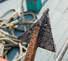 Rusted boat-anchor tip, on board by SheriarIrani