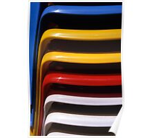 Stacked Coloured Plastic Chairs Poster