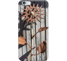 Metal flower sculpture in sun iPhone Case/Skin