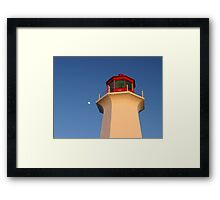 Moon rising over head of Peggys Cove Lighthouse Framed Print