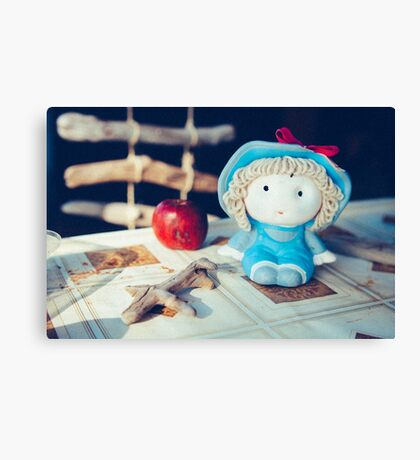 small dolly with apple Canvas Print