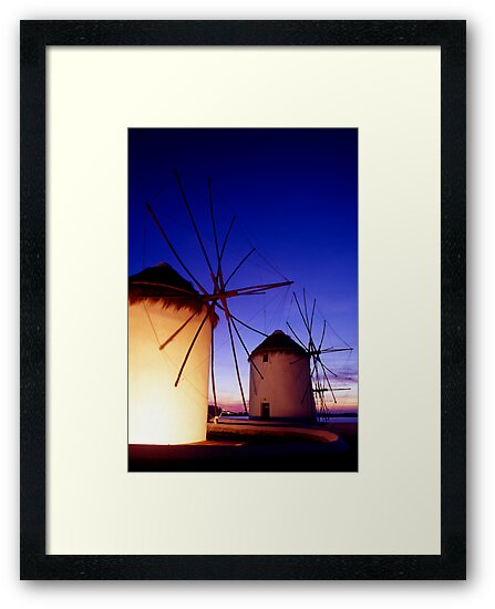 Greece. Mykonos Town. Illuminated windmills at dusk. by Steve Outram