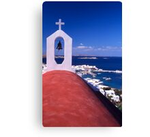 Greece. Cyclades Islands. Mykonos. Greek Orthodox Church and the harbour in Mykonos Town. Canvas Print