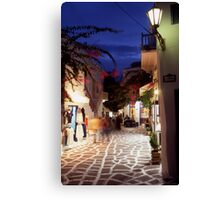 Greece. Cyclades Islands. Mykonos. An alleyway in Mykonos Town at night. Canvas Print