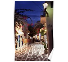 Greece. Cyclades Islands. Mykonos. An alleyway in Mykonos Town at night. Poster