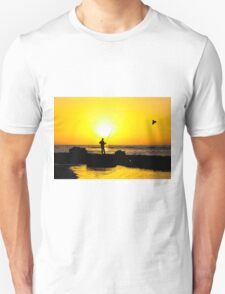 Silhouette of a man fishing on a beach at sunset Unisex T-Shirt