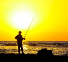 Silhouette of a man fishing on a beach at sunset Sticker