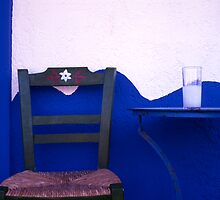 A glass of ouzo on a taverna table. South Crete. Greece. by Steve Outram