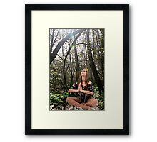 Teen Hippie girl meditates outdoors in a forest  Framed Print