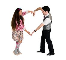 Valentine's Day - Young couple forms a heart shape with their arms  by PhotoStock-Isra