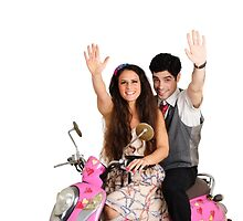 Valentine's - young couple on a pink scooter decorated with hearts  by PhotoStock-Isra