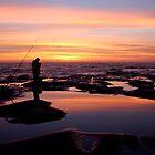 Lone fisherman Avoca rock platform by Chris Allen