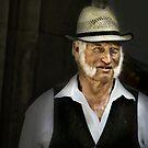 Man with straw hat and impressive beard by Kurt  Tutschek