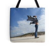 Spiritual young woman communicates with the spirits on a beach Tote Bag