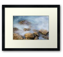 misty water spray and rocks Framed Print