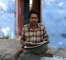 Man Reading Paper by AimeeT