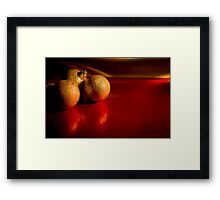 Christmas golden baubles on red background Framed Print