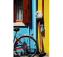 belongings being bicycles brooms and brushes  Photographic Print