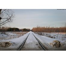 Looking Down The Snowy Railroad Tracks Photographic Print