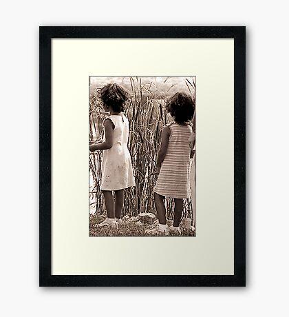 girls watching Framed Print