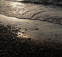 Golden Foam and Pebbles - Early Light at the Breakwater by Georgia Mizuleva