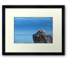 Rock against the sea Framed Print