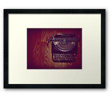 Typewriter on hardwood floor Framed Print