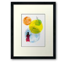 Girl Flying her Kite Framed Print