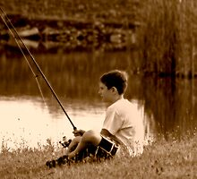 A boy fishing by deahna