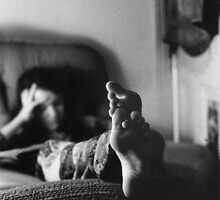 Michelles feet on the Sofa in the House on Cardigan Street by Philip  Rogan