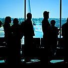 Airport Travelers by Karin  Hildebrand Lau