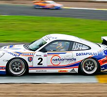 Tim Harvey racing his Porsche Carrera to victory by John Stewart