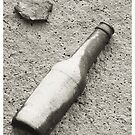 Bottle in the mud by TriciaDanby