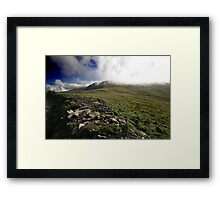 Fog rolls over the hill Framed Print