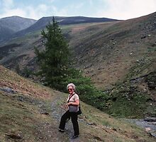 Marj about to go alone on Skiddaw Lake District England 198405240012 by Fred Mitchell