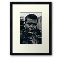 The face of an extra Framed Print