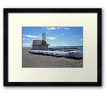 Boats on a beach Framed Print
