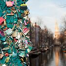 Amsterdam The Netherlands Lovers locks hang from the bridge across the Groenburgwal. by stuwdamdorp