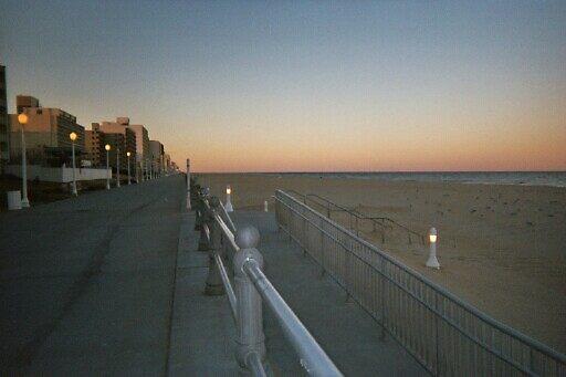 sunset on the beach by NEIL STUART COFFEY