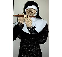 Nun playing the flute  (statue)  Photographic Print